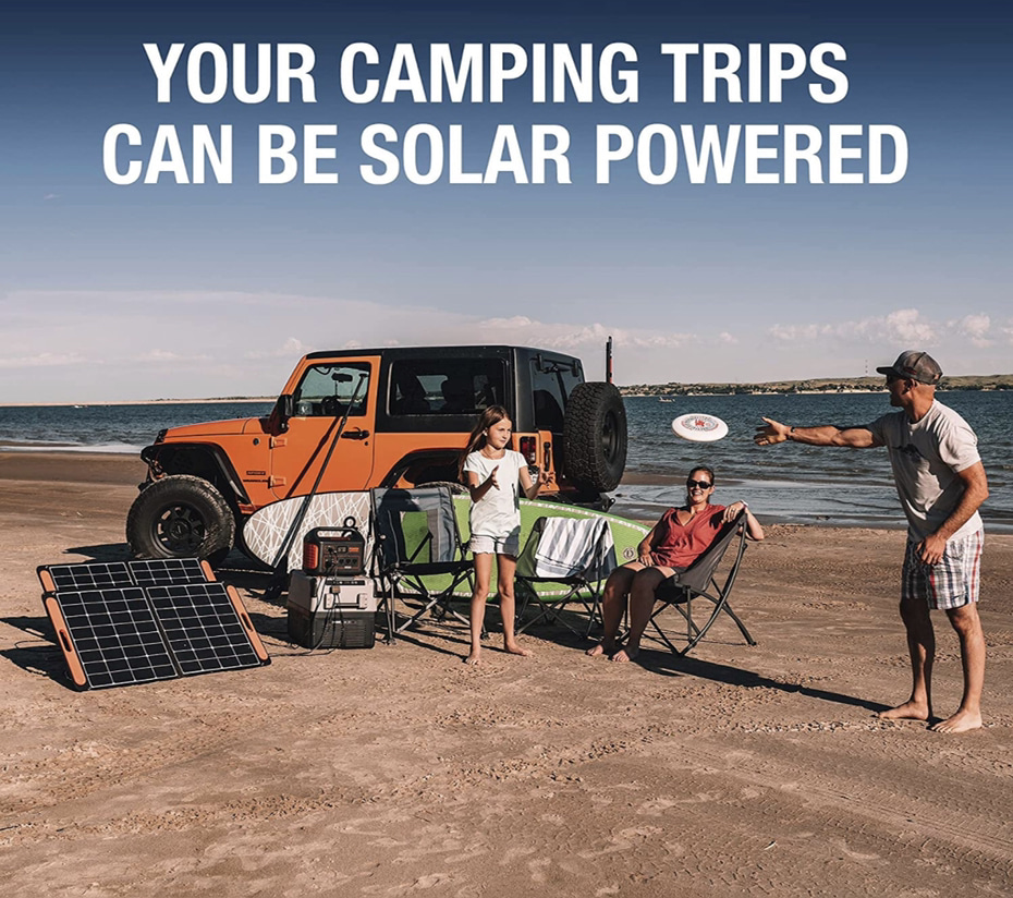 A display of a family camping on the beach with a solar generator